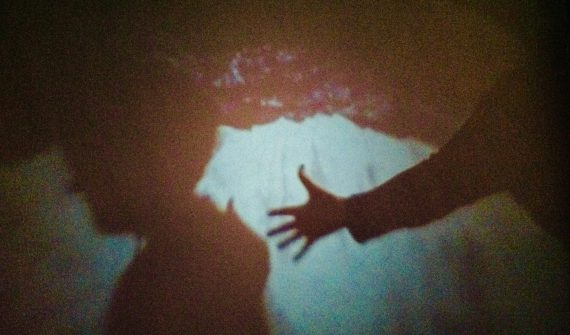 Image taken inside Camera Obscura with iPad (hand outstretched) - Louise Newham, courtesy Project Art Works